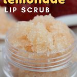 This easy homemade strawberry lemonade lip scrub smells amazing and helps lips feel silky smooth.